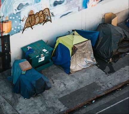 tents of homeless population alongside street