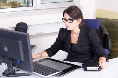 female accountant working at her computer